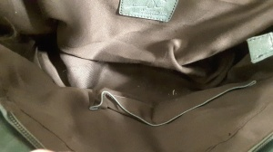 Check the lining of the purse for discoloration or tears.